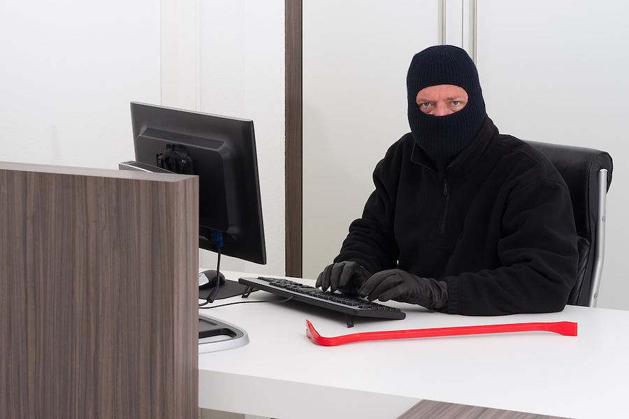 A burglar is robbing knowledge from a company