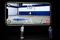 CEO and founder of HomeCourt David Lee, right, and former NBA player Steve Nash talk about the Apple iPhone XS at the Steve Jobs Theater during an event to announce new Apple products Wednesday, Sept. 12, 2018, in Cupertino, Calif. (AP Photo/Marcio Jose Sanchez)
