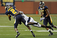 26 December 2010:  FIU cornerback Jonathan Cyprien (25) tackles Toledo quarterback Terrance Owens (2) in the fourth quarter as the FIU Golden Panthers defeated the University of Toledo Rockets, 34-32, to win the 2010 Little Caesars Pizza Bowl at Ford Field in Detroit, Michigan.
