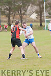 Annascaul Aidan Crean in possession of the ball closely watched by Sneem/Derrynane Ian Galvin during the Junior Premier Championship Qualifier match at the Paddy Kennedy Memorial Park, Annascaul, on Sunday afternoon.