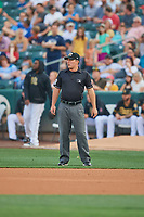 First base umpire Sean Ryan handles the calls on the bases during the game between the Salt Lake Bees and the El Paso Chihuahuas at Smith's Ballpark on August 13, 2018 in Salt Lake City, Utah. Salt Lake defeated El Paso 4-3. (Stephen Smith/Four Seam Images)