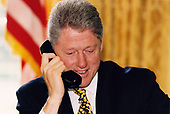 United States President Bill Clinton telephones Mayor Ronald Norick of Oklahoma City, Oklahoma from the Oval Office of the White House in Washington, DC on July 27, 1995.  The President called Mayor Norick to tell him he signed the rescission bill that includes $39 million in funding to restore and revitalize the area that was affected by the bombing of the Alfred P. Murrah Federal Building in downtown Oklahoma City, OK, that killed 168 people.<br />