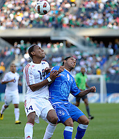 Cuba's Alianni Urgelles battles for the ball with El Salvador's Rudis Corrales.  El Salvador defeated Cuba 6-1 at the 2011 CONCACAF Gold Cup at Soldier Field in Chicago, IL on June 12, 2011.