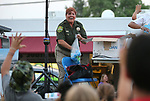 Carson City Sheriff's DARE Officer Lisa Davis throws collectible items from the stage at the 16th annual National Night Out event, hosted by the Carson City Sheriff's Office, in Carson City, Nev., on Tuesday, Aug. 7, 2018.<br />