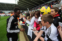 Wednesday, 23 April 2014<br /> Pictured: Nathan Dyer signing autographs for supporters.<br /> Re: Swansea City FC are holding an open training session for their supporters at the Liberty Stadium, south Wales,