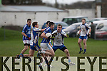 Bursting forward<br /> --------------------<br /> Shane McSweeney,Laune Rangers charges forward with Aaron Cahillane,Keel, tries to hold his advance when the sides met in the replay of the Mid Kerry Championship in Killorglin last Sunday.