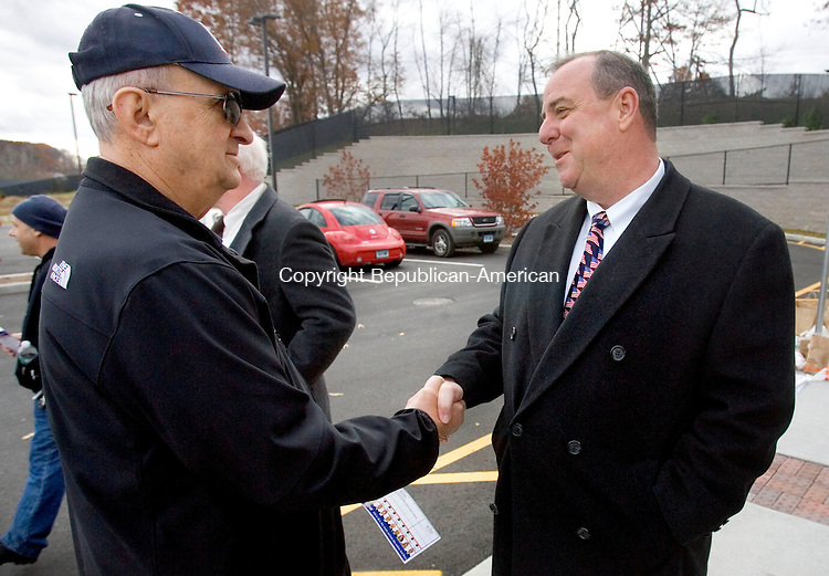 WATERBURY CT. 04 November 2013-110513SV07-From left, David Ford of Waterbury meets with Mayor Neil O&rsquo;Leary, Democratic Candidate for Mayor, before voting at Carrington School in Waterbury Tuesday.<br /> Steven Valenti Republican-American