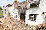 Country cottage homes burnt out destroyed by fire left in ruins, Redlynch, near Bruton, Somerset, England, UK