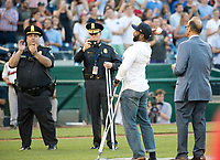 United States Capitol Police Officer David Bailey, second right, who was wounded in yesterday's attack in Virginia throws out the ceremonial first ball under the gaze of former New York Yankee manager Joe Torre, right, prior to the 56th Annual Congressional Baseball Game for Charity where the Democrats play the Republicans in a friendly game of baseball at Nationals Park in Washington, DC on Thursday, June 15, 2017. Photo Credit: Ron Sachs/CNP/AdMedia