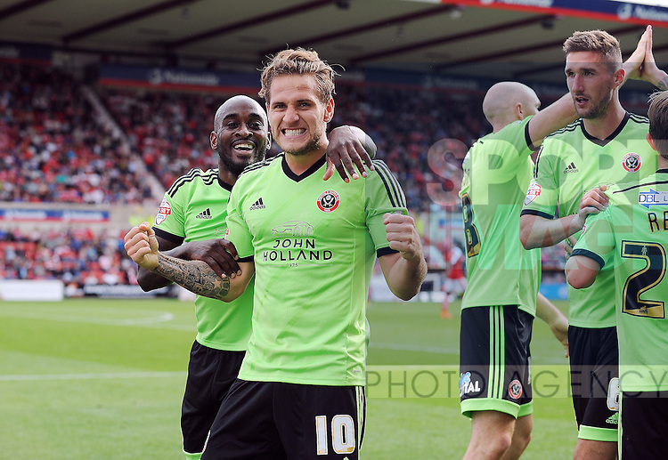Billy Sharp of Sheffield United celebrates scoring his goal to make it 2-0 with team mates<br /> - English League One - Swindon Town vs Sheffield Utd - County Ground Stadium - Swindon - England - 29th August 2015<br /> --------------------