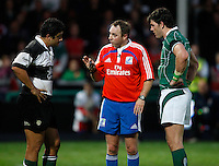 Photo: Richard Lane/Richard Lane Photography. .Barbarians v Ireland. The Gartmore Challenge. 27/05/2008. Barbarians' Morgan Turinui and Ireland's Shane Horgan and spoken to by  referee Andrew Small.