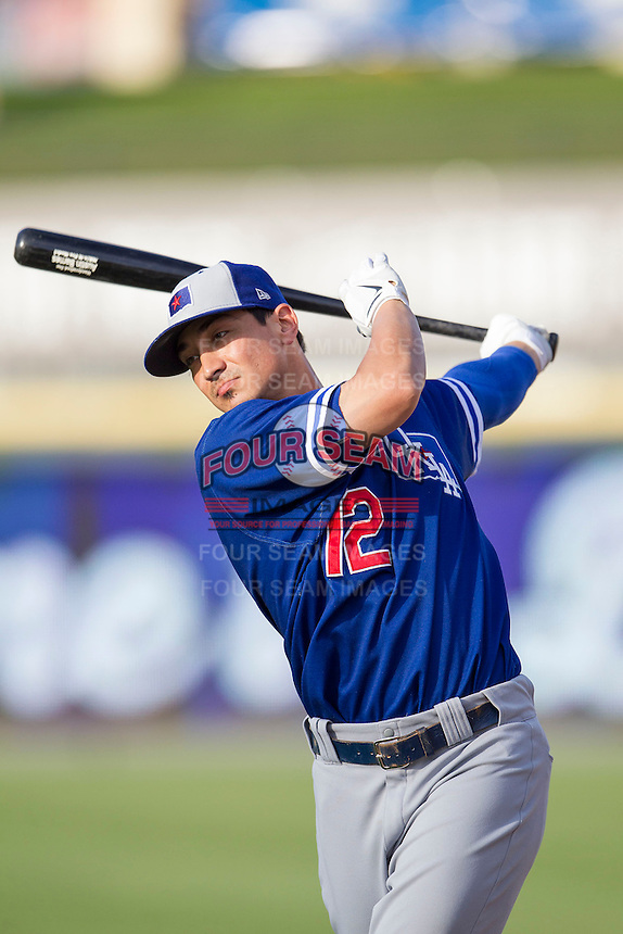 Oklahoma City Dodgers second baseman Darwin Barney (12) warms up before the Pacific Coast League baseball game against the Round Rock Express on June 9, 2015 at the Dell Diamond in Round Rock, Texas. The Dodgers defeated the Express 6-3. (Andrew Woolley/Four Seam Images)
