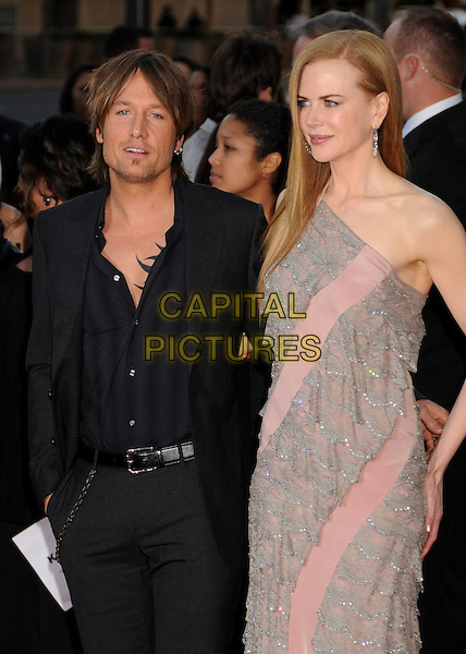 KEITH URBAN & NICOLE KIDMAN.The 2009 American Music Awards held at The Nokia Theatre L.A. Live in Los Angeles, California, USA. .November 22nd, 2009.AMA AMA's half length pink grey gray lace dress black suit jacket married husband wife  one shoulder.CAP/ADM/BP.©Byron Purvis/AdMedia/Capital Pictures.
