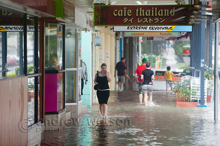 Shops flooded due to torrential rain and king tides on Aplin Street.  Cairns, Queensland, Australia