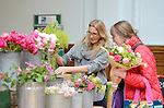 A visitor buys a bunch of flowers at an RHS Secret Garden Sunday.