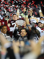 Jan 7, 2010; Pasadena, CA, USA; Alabama Crimson Tide head coach Nick Saban holds up the Coaches' Trophy and celebrates after defeating the Texas Longhorns 37-21 in the 2010 BCS national championship game at the Rose Bowl. Mandatory Credit: Mark J. Rebilas-.
