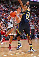 Ohio State Buckeyes guard Aaron Craft (4) looks for an open teammate as he gets by Michigan Wolverines forward Jon Horford (15) in second half action at Nationwide Arena on February 11,  2014. (Chris Russell/Dispatch Photo)