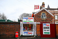 A flag is removed from the top of a fast food outlet as high winds are felt around Anfield<br /> <br /> Photographer Alex Dodd/CameraSport<br /> <br /> The Premier League - Liverpool v Burnley - Sunday 10th March 2019 - Anfield - Liverpool<br /> <br /> World Copyright © 2019 CameraSport. All rights reserved. 43 Linden Ave. Countesthorpe. Leicester. England. LE8 5PG - Tel: +44 (0) 116 277 4147 - admin@camerasport.com - www.camerasport.com