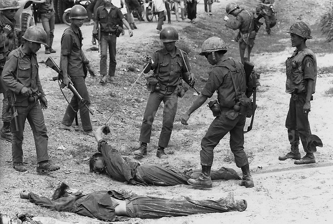 South Vietnamese troops gather the bodies of North Vietnamese soldiers killed in battle during the Easter Offensive, near Quang Tri, South Vietnam, April 1972