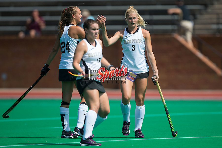 Jess Newak (3) of the Wake Forest Demon Deacons high fives teammate Jule Grashoff (24) after scoring a goal during first half action against the Missouri State Bears at Kentner Stadium on September 6, 2015 in Winston-Salem, North Carolina.  The Demon Deacons defeated the Bears 2-0.  (Brian Westerholt/Sports On Film)