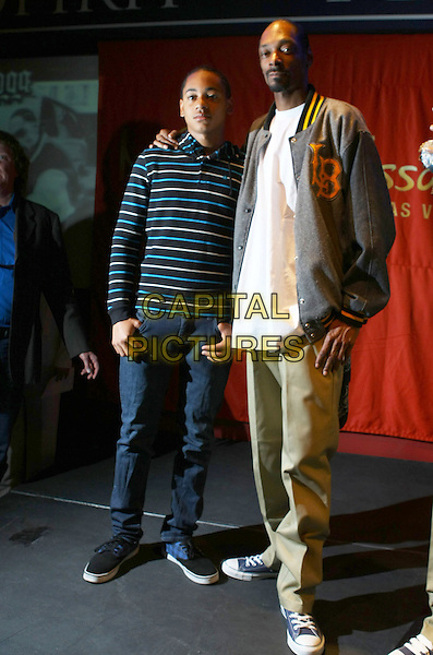 CORDELL & SNOOP DOGG (Cordozar Calvin Broadus, Jr.) .Snoop Dogg unveiling at Madame Tussauds Las Vegas located at the Venetian Resort Hotel and Casino, Las Vegas, Nevada, USA..April 20th, 2009.full length grey gray jacket beige trousers khaki blue striped stripes top father dad son family goatee facial hair .CAP/ADM/MJT.© MJT/AdMedia/Capital Pictures.