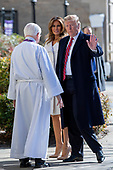 United States President Donald J. Trump (R) and First Lady Melania Trump (C) are greeted by Reverend W. Bruce McPherson (C) as they arrive to attend services at St. John's Episcopal Church in Washington, DC, USA, 17 March 2019. The Trumps are attending church on St. Patrick's Day.<br /> Credit: Erik S. Lesser / Pool via CNP