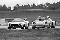 #68 Porsche Carrera RSR of Luis Mendez, Mandy Gonzalez, and Tato Ferrer 23rd place finish, and the #66 Ferrari 1978 24 Hours of Daytona, Daytona International Speedway, Daytona Beach, FL, February 5, 1978.  (Photo by Brian Cleary/www.bcpix.com)