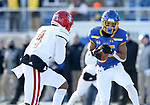 BROOKINGS, SD - NOVEMBER 17: Cade Johnson #15 from South Dakota State University makes a catch in front of Elijah Reed #4 from the University of South Dakota during their game Saturday afternoon at Dana J. Dykhouse Stadium in Brookings, SD. (Photo by Dave Eggen/Inertia)