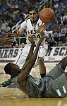 Hug's Robin Dhatt tries to grab the ball from Green Valley's Durrell McDonald during a semi-final game in the NIAA 4A State Basketball Championships between Hug and Green Valley high schools at Lawlor Events Center in Reno, Nev, on Thursday, Feb. 23, 2012. Hug won 70-68..Photo by Cathleen Allison