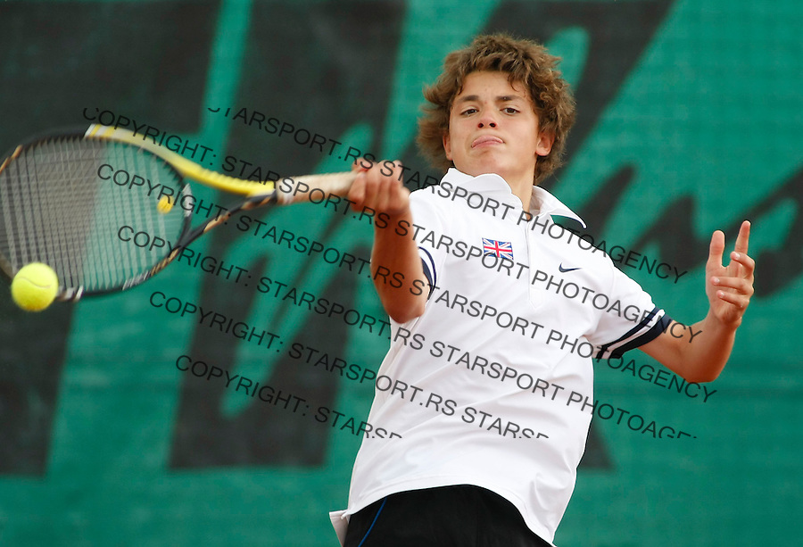 Tenis, World Championship U-14.World U-14 championship.Great Britain Vs. Korea.Peter Ashley Vs. Geon Ju Shin.Peter Ashley, returns.Prostejov, 04.08.2010..foto: Srdjan Stevanovic/Starsportphoto ©