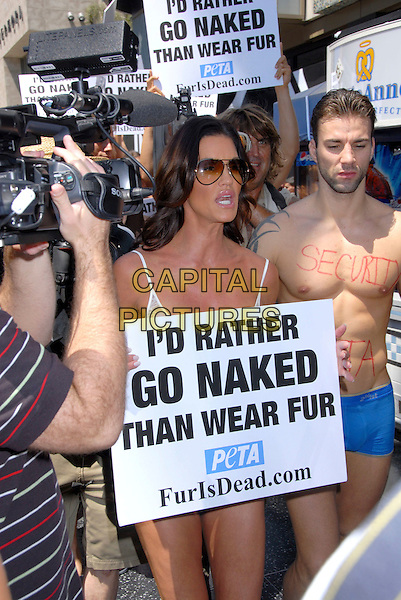 "JANICE Dickinson & models.Janice Dickinson Modeling Agency Announces ""No Fur"" Policy on Hollywood Blvd at Hollywood & Highland, Hollywood, LA, California, USA,.20 August 2007..half protesting campaigning Peta holding signs stripping taking off clothes underwear.CAP/ADM/BP.©Byron Purvis/AdMedia/Capital Pictures."