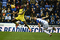 Lucas Akins of Burton Albion is challenged by Chris Gunter of Reading during the Sky Bet Championship match between Reading and Burton Albion at the Madejski Stadium, Reading, England on 23 December 2017. Photo by Paul Paxford.