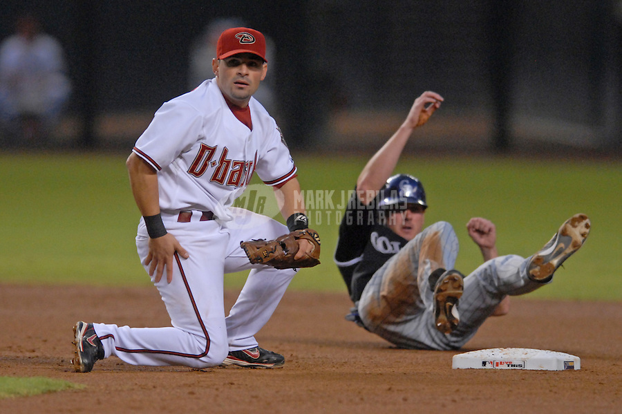 Oct 11, 2007; Phoenix, AZ, USA; Arizona Diamondbacks second baseman (11) Augie Ojeda looks towards first base after being taken out by Colorado Rockies right fielder (11) Brad Hawpe while completing a double play in the second inning during game 1 of the 2007 National League Championship Series at Chase Field. Mandatory Credit: Mark J. Rebilas-US PRESSWIRE