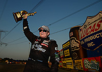 Jul. 1, 2012; Joliet, IL, USA: NHRA  pro stock driver Erica Enders celebrates after winning her first Wally at the Route 66 Nationals at Route 66 Raceway. Mandatory Credit: Mark J. Rebilas-