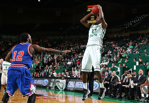 Denton, TX - NOVEMBER 28: Jordan Williams #23 of the North Texas Mean Green shoots over Shaquille White-Miller #12 of the Texas-Arlington Mavericks at the Super Pit on November 28, 2012 in Denton, Texas. (Photo by Rick Yeatts)