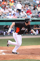 Miami Marlins Jordan Brown (61) hustles down the first base line against the Houston Astros during a spring training game at the Roger Dean Complex in Jupiter, Florida on March 12, 2013. Houston defeated Miami 9-4. (Stacy Jo Grant/Four Seam Images)........