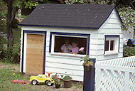 Ile D'Orleans, Quebec City Area, Canada, June 8, 1984. Children playing in a miniature house.