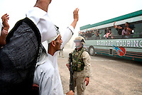 Iraqis salut released prisoners outside of  the prison of Abu Graib in BAghdad on MAy 28 2004. in the same day 400 prisoners will be relased.