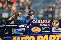 Oct 14, 2016; Ennis, TX, USA; Crew member for NHRA funny car driver Ron Capps during qualifying for the Fall Nationals at Texas Motorplex. Mandatory Credit: Mark J. Rebilas-USA TODAY Sports