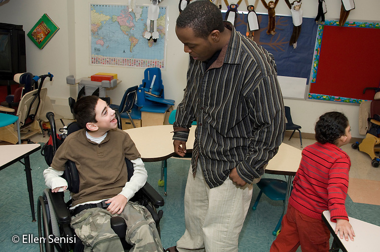 MR / Albany, NY.Langan School at Center for Disability Services .Ungraded private school which serves individuals with multiple disabilities.Teaching assistant (African-American) and child interact. Boy: 11, cerebral palsy, expressive and receptive language delays.MR: Bro12; Wes2.© Ellen B. Senisi