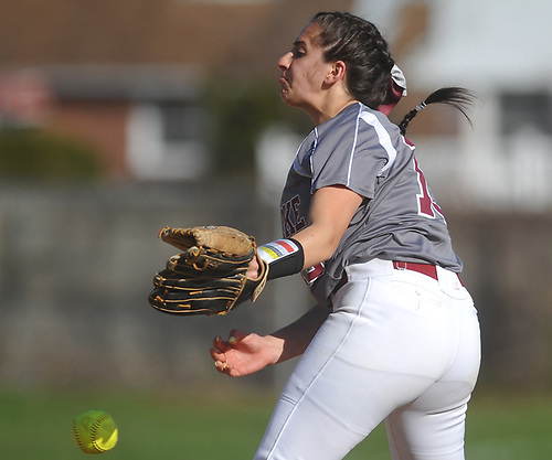 Lizzy Belfiore #19, Clarke pitcher, delivers to the plate during a Nassau County Conference ABC-II varsity softball game against Division Avenue at Clarke High School on Thursday, April 26, 2018. Clarke won by a score of 4-2.