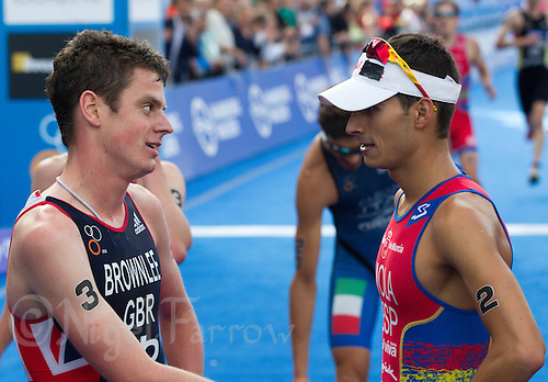 12 JUL 2014 - HAMBURG, GER - Jonathan Brownlee (GBR) (left) from Great Britain talks with Mario Mola (ESP) of Spain after the finish of the elite men's 2014 ITU World Triathlon Series round in the Altstadt Quarter, Hamburg, Germany (PHOTO COPYRIGHT © 2014 NIGEL FARROW, ALL RIGHTS RESERVED)