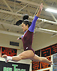 Mattea Gravina of Bay Shore-Islip performs her routine on the balance beam during the Suffolk County varsity girls' gymnastics individual championships at Babylon High School on Friday, November 6, 2015.<br /> <br /> James Escher