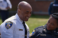 Baltimore, MD - April 25, 2015: Baltimore City police commissioner Anthony Batts chats with an officer along the police line outside of the Baltimore Police Department's Western District Headquarters, April 25, 2015, as protestors gathered nearby to demand police accountability in the death of Freddie Gray and protest police brutality. Gray died of a broken spine while in police custody.  (Photo by Don Baxter/Media Images International)