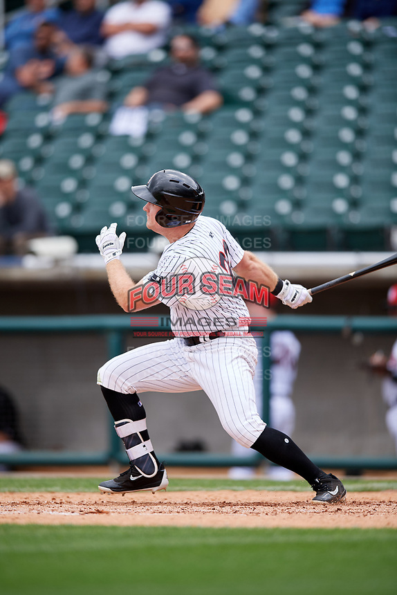 Birmingham Barons right fielder Mason Robbins (20) follows through on a swing during a game against the Jacksonville Jumbo Shrimp on April 24, 2017 at Regions Field in Birmingham, Alabama.  Jacksonville defeated Birmingham 4-1.  (Mike Janes/Four Seam Images)
