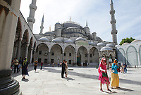 ISTANBUL,TURKEY - MAY 16: Tourists enjoying at the Blue Mosque in Istanbul,Turkey. The Blue Mosque is an Ottoman mosque, was built between 1609-1616 and is situated in the district of Eminönü, in the district of Fatih in front of the Basilica of Saint Sophia.