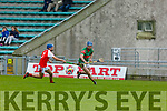 Crotta O'Neills Raymond Nolan in possession as Liam Twomey of Kenmare Kilgarvan attempts to block his effort in the U21 Hurling Championship semi final in Austin Stacks Park on Sunday.