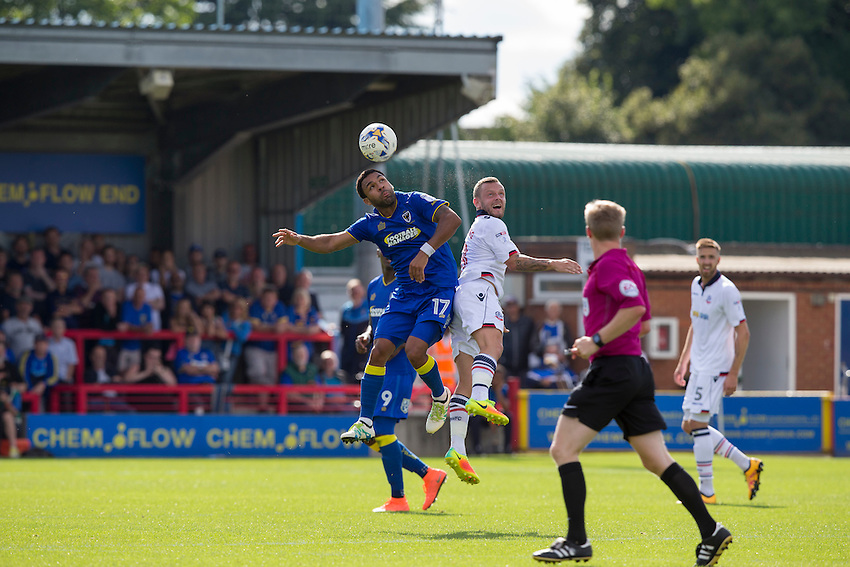 AFC Wimbledon's Andy Barcham battles for possession with Bolton Wanderers' Jay Spearing<br /> <br /> Photographer Craig Mercer/CameraSport<br /> <br /> Football - The EFL Sky Bet League One - AFC Wimbledon v Bolton Wanderers - Saturday 13th August 2016 - The Cherry Red Records Stadium - London<br /> <br /> World Copyright &copy; 2016 CameraSport. All rights reserved. 43 Linden Ave. Countesthorpe. Leicester. England. LE8 5PG - Tel: +44 (0) 116 277 4147 - admin@camerasport.com - www.camerasport.com