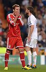 Mario Gotze vies with Xabi Alonso during the UEFA Champions League semifinal first leg football match Real Madrid CF vs FC Bayern Munchen at the Santiago Bernabeu stadium in Madrid in Madrid on April 23, 2014.   PHOTOCALL3000/ DP