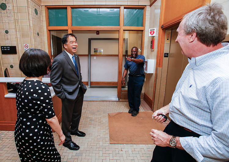 DePaul President A. Gabriel Esteban, Ph.D., left, and his wife Josephine share a laugh with custodian Michael Perkins and Bob Janis, right, of facility operations Wednesday, July 5, 2017. during a tour of the Loop campus. <br /> (DePaul University/Jamie Moncrief)